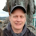 picture of Jay Ball wearing a grey baseball cap